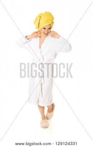 Full length young smiling woman in bathrobe