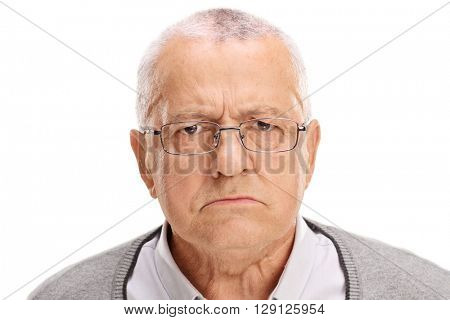Portrait of an angry senior frowning and looking at the camera isolated on white background