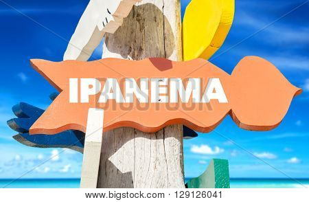 Ipanema signpost with beach background