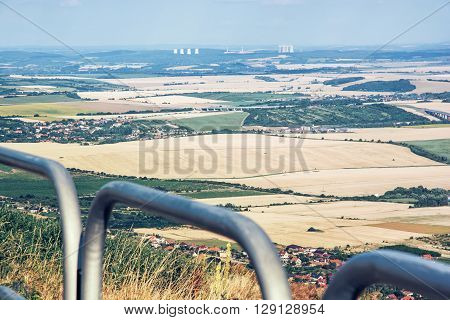 Rural landscape from the hill Zobor near the Nitra city Slovak republic. Mochovce nuclear power plant in the distance. Meadows and fields.