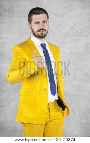 Happy Businessman In Gold Suit Show Thumbs Up