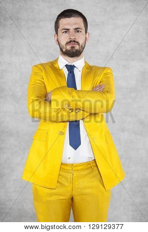 business man shows who is boss, gold suit