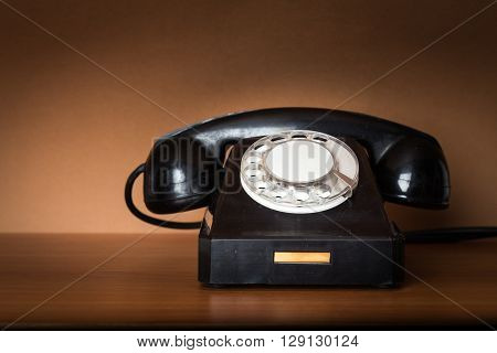 Old Retro telephone on the wooden table