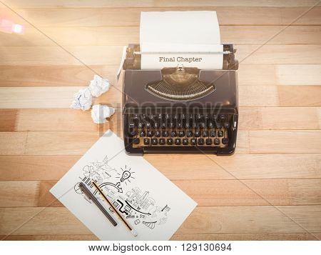 The word final chapter and brainstorm graphic against typewriter and paper on table in office