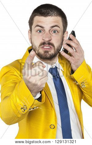 Not Happy Businessman Talking On The Phone And Threatens Finger
