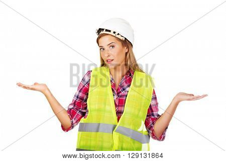 Female builder making do not know sign