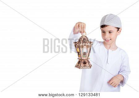 Ramadan Kareem - Ramadan Greeting Card - Happy young kid playing with Ramadan lantern