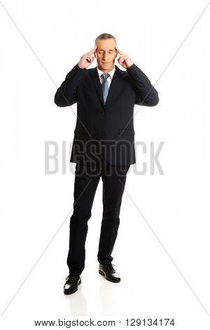 Pensive businessman touching head