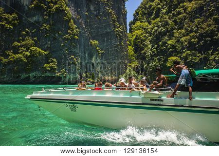 Phuket Thailand - August 19 2015: Speedboat with tourists heading to Phi Phi Island in the Andaman Sea