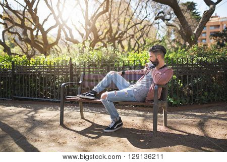 Resting On The Bench In The Park