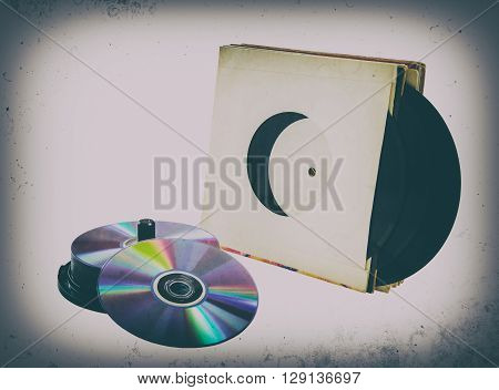 vinyl records and cd CD-R DVD on a white background. isolated; retro style vintage old photo