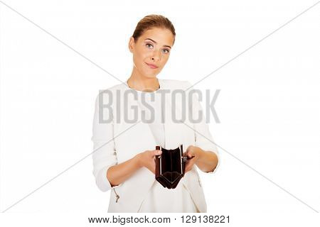 Young businesswoman holds empty wallet
