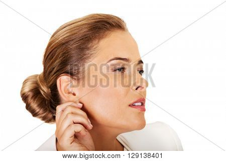 Beautiful businesswoman overhears a conversation