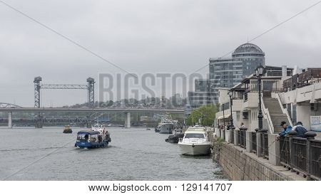 ROSTOV-ON-DON RUSSIA- MAY 0: By the Don River are going ships. From waterfront fishermen catch fish on May 01 2015 in Rostov-on-Don