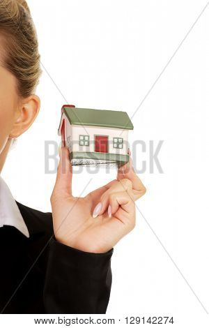 Young businesswoman presenting a model house