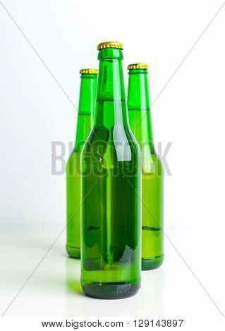 Row of beer bottles isolated on white