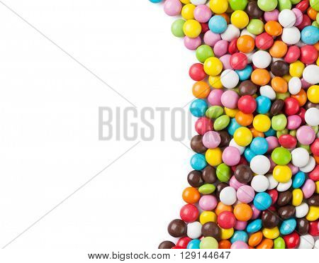 Colorful candies frame. Isolated on white background