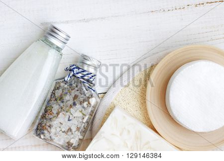 Bath skincare products. Herbal salt blend,cleansing milk, cotton pads, soap. Top view spa background.