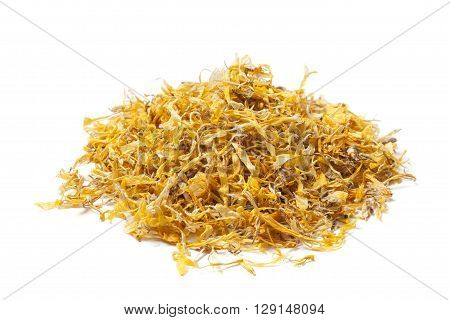 pile of dried flowers and blossoms of calendula on white background. Annual flowers with yellow to bright orange.