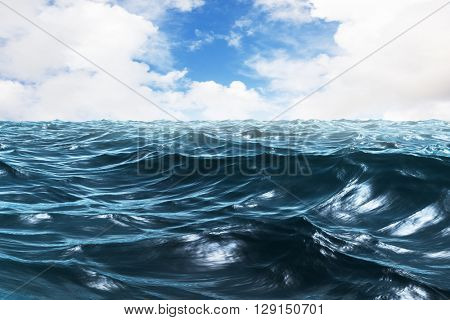 Blue rough ocean against blue sky with white clouds