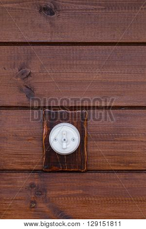 Retro light switch placed on wooden background