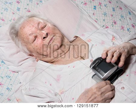 Old Woman With Arterial Pressure Measure