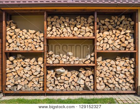 Stack of firewood ready for the fireplace divided in square boxes