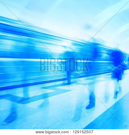 Abstract image of blurred people walking at subway station.