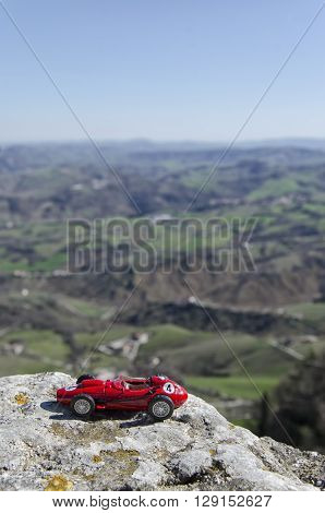 Scale model of famous red car with a panoramic background