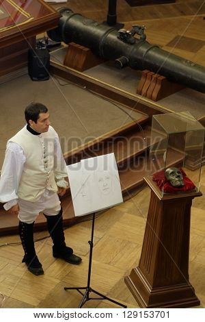 ST. PETERSBURG, RUSSIA - APRIL 27, 2016: Author of ??Suvorov. Alps. 200 years ago Alexey Egorov shows the portrait of A. V. Suvorov reconstructed by his death mask in Gerasimov laboratory