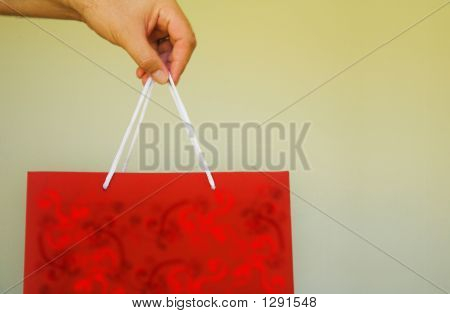 Red Gift Bag In Man'S Hand