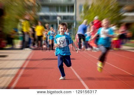 Young Preschool Children, Running On Track In A Marathon Competition