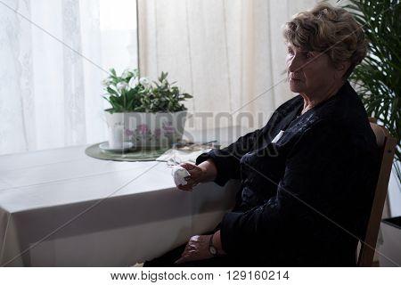 Sad Elderly Lady In Black