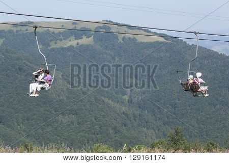 PYLYPETS UKRAINE - AUGUST 6 2015: Cableway to Pylypets in Karpaty. There are a lot of tourists even in summer