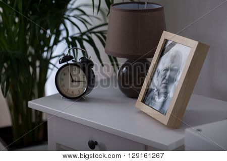 Framed picture of an elderly man who died