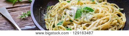 Italian pasta pesto style spaghetti with basil