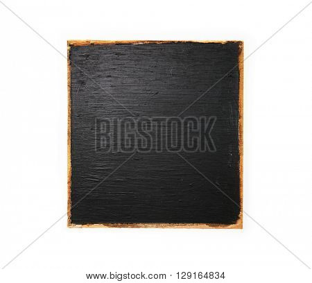 A black board like detached old wood paneling with black paint and unpainted edges.