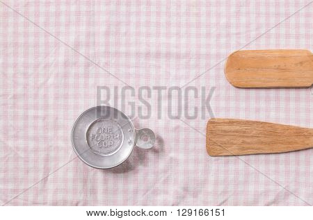 Small paddle and tray for cooking sweet tablecloth background