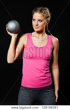 Beautiful young woman is exercising with medicine ball.