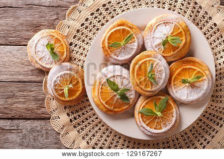 Cookies With Oranges, Decorated With Mint And Powdered Sugar Close-up. Horizontal Top View