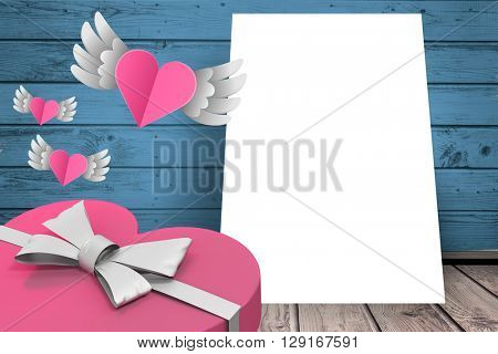 Hearts with wings flying on a sheet of paper