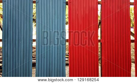 Blue and red galvanized iron plate fence