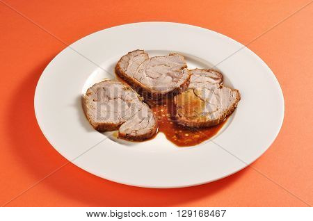 Plate with a portion of three slices of roasted veal portion