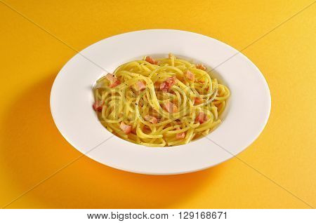 Plate with a portion of spaghetti carbonara