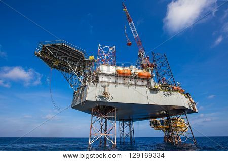 Oil and gas drilling rig just completion on oil and gas wellhead platform