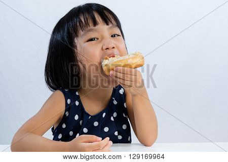 Asian Little Chinese Girl Eating Donuts