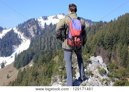 hiker with backpack is viewing to mountains