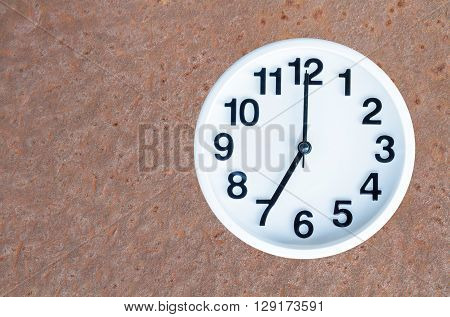 Clock On Steel Rusty Background