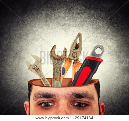man with the open head and tools