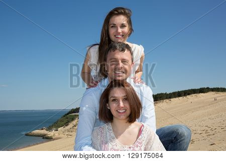 Family Piggybacking Their Daughter On The Ocean